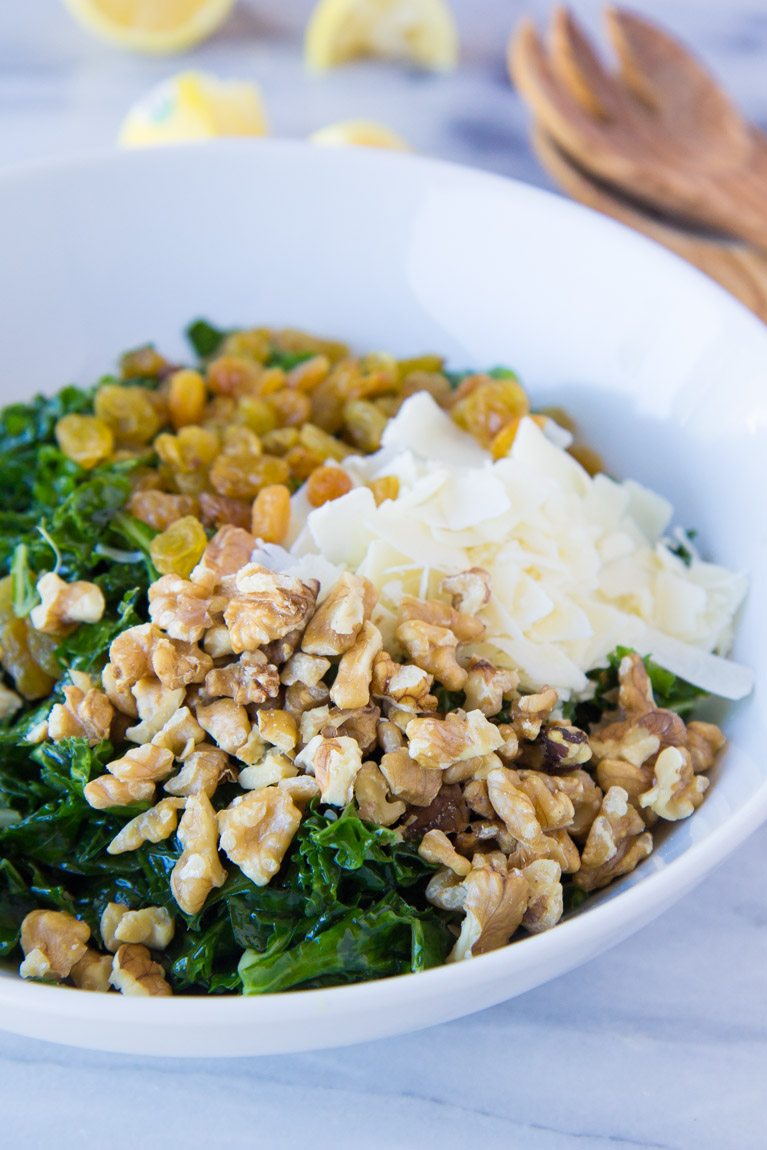 Simple Kale Salad: The perfect healthy side dish or entree filled with healthy fats from walnuts and olive oil!  A way to fall in LOVE with kale.
