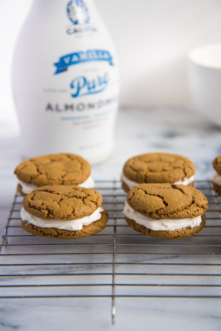 Soft Gingerbread Sandwich Cookies that pair perfectly with Califia Farms Vanilla Almondmilk! #spon #vegan