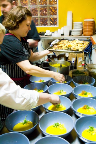 Chefs Rebecca Masson & Brandi Key prepping the Ricotta Gnocchi, Pickled Corn, Micro Basil, Saffron Broth \\ Aces of Taste