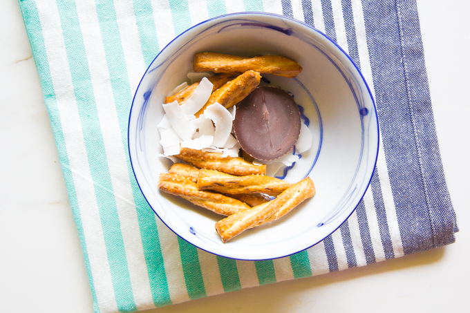 snack idea = honey wheat pretzels, Justin's pb cup, coconut chips \\ immaEATthat.com