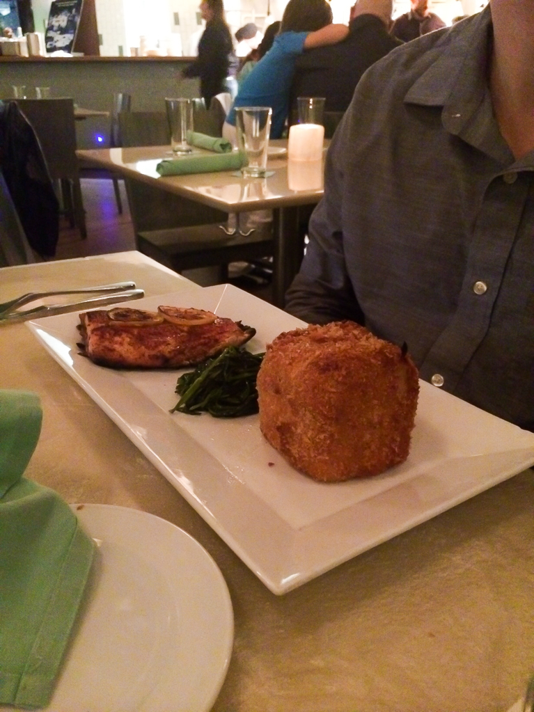 Dinner at Reef. Redfish on the half-shell served with sauteed greens and fried mac & cheese.