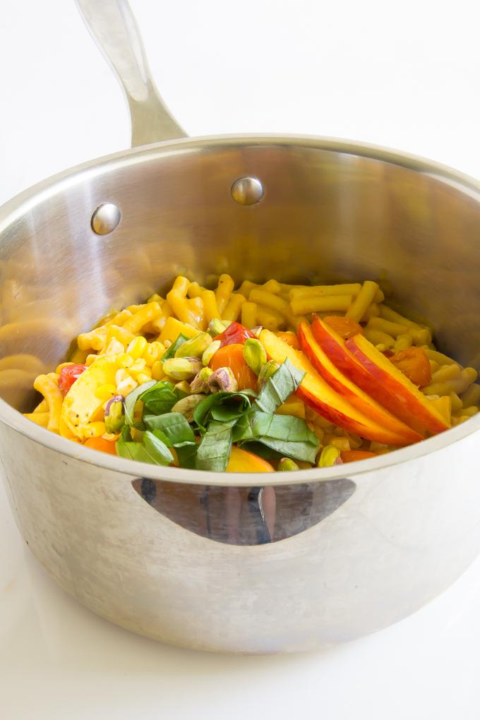 Summer Mac & Cheese - corn, cherry tomatoes, squash, basil, pistachios, peaches \\ immaEATthat.com